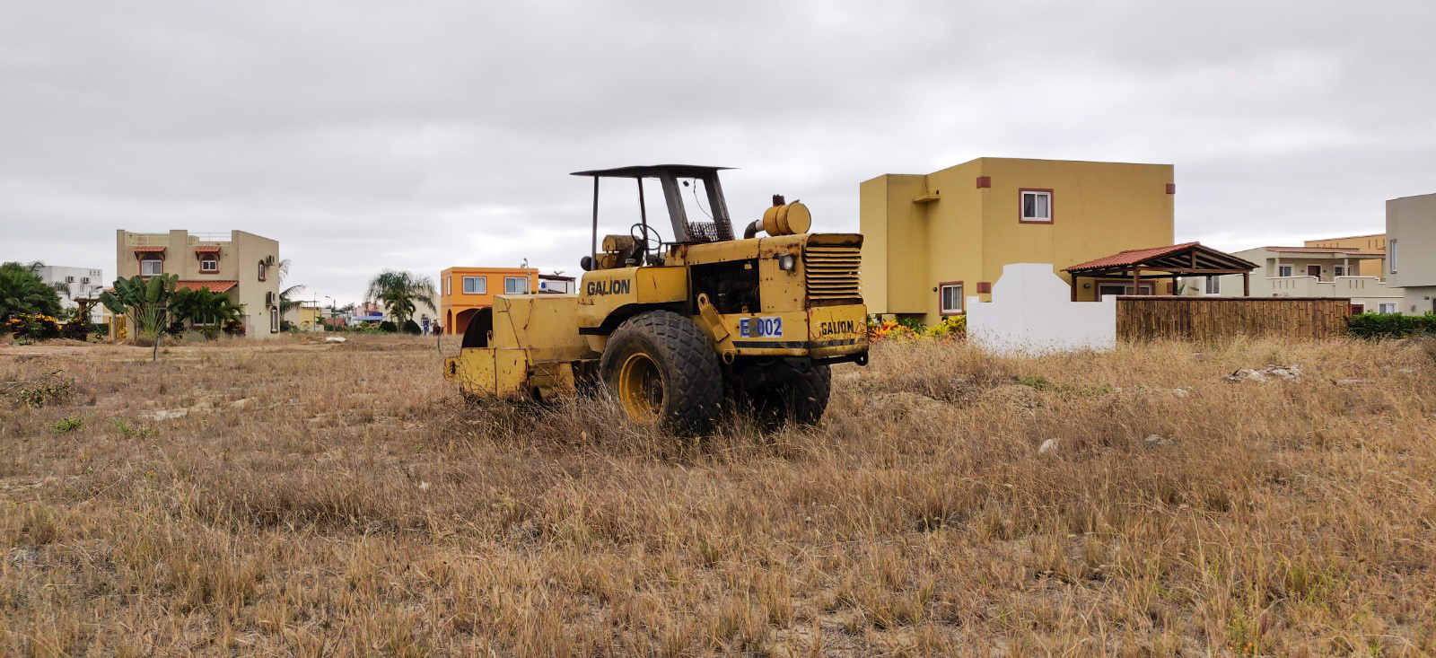 Heavy machinery left to rust in someone's undeveloped lot